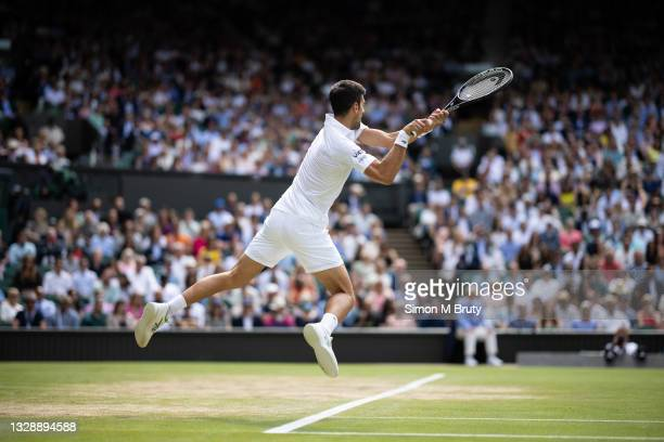 Novak Djokovic of Serbia in action during the Men's Singles Final against Matteo Berrettini of Italy at The Wimbledon Lawn Tennis Championship at the...