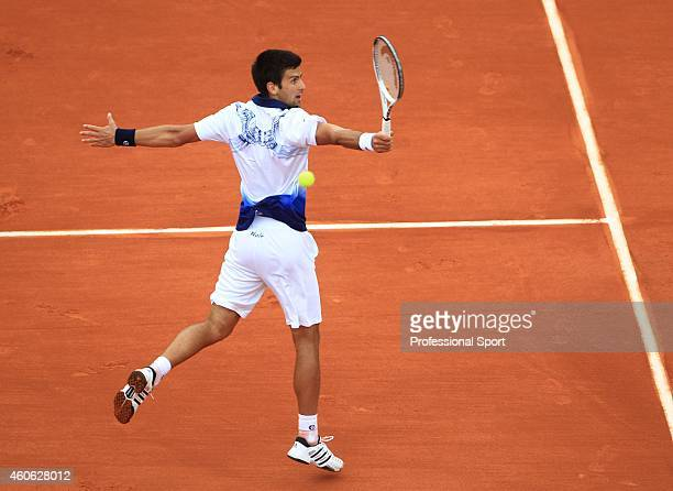 Novak Djokovic of Serbia in action during the men's singles fourth round match against Robby Ginepri of the United States on day nine of the French...