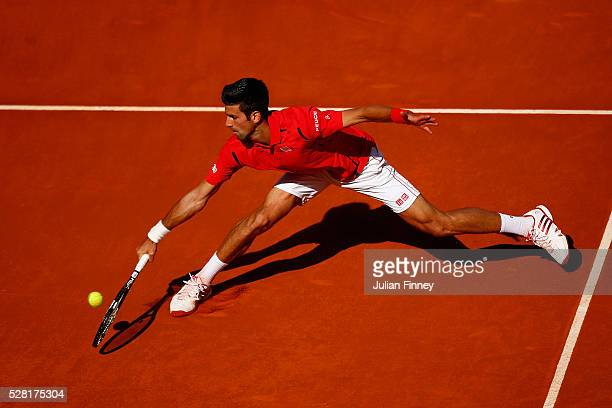 Novak Djokovic of Serbia in action in his match against Borna Coric of Croatia during day five of the Mutua Madrid Open tennis tournament at the Caja...