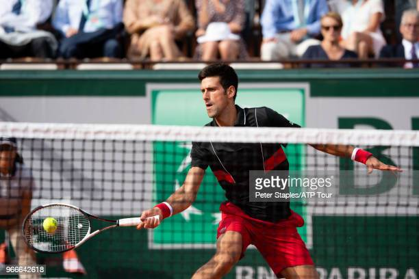 Novak Djokovic of Serbia in action volleying at the net against Fernando Verdasco of Spain on Court Philippe-Chatrier in the Men's Singles...