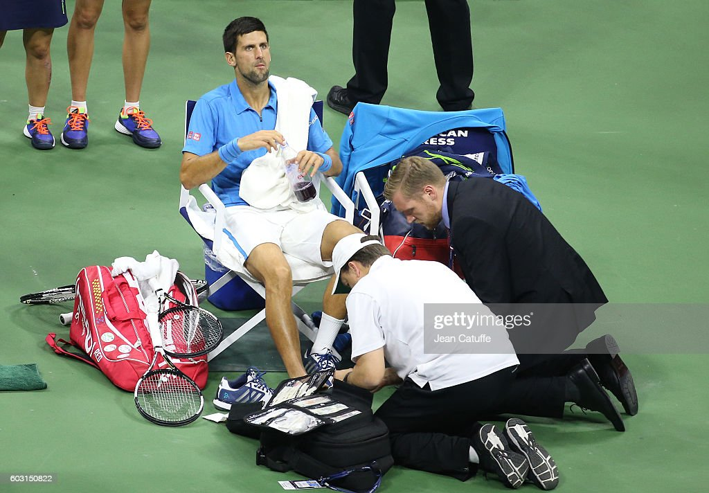 Novak Djokovic of Serbia is being treated on court against Stanislas Wawrinka of Switzerland during the men's final at Arthur Ashe Stadium on day 14 of the 2016 US Open at USTA Billie Jean King National Tennis Center on September 11, 2016 in New York City.