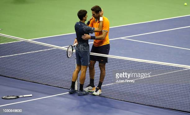 Novak Djokovic of Serbia is congratulated after winning his men's Singles finals match against Juan Martin del Potro of Argentina on Day Fourteen of...