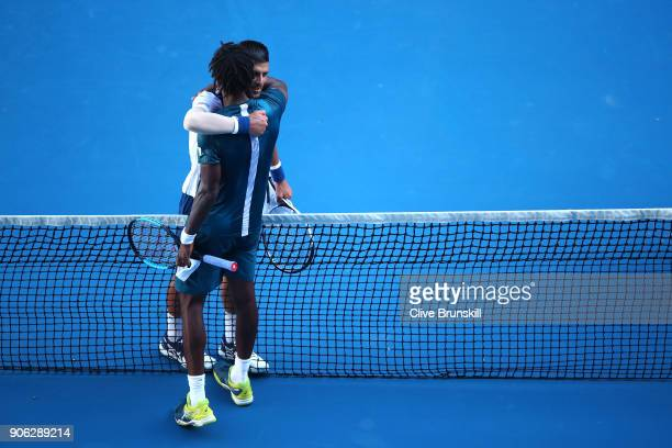 Novak Djokovic of Serbia is congratulated by Gael Monfils of France after Djokovic won their second round match on day four of the 2018 Australian...