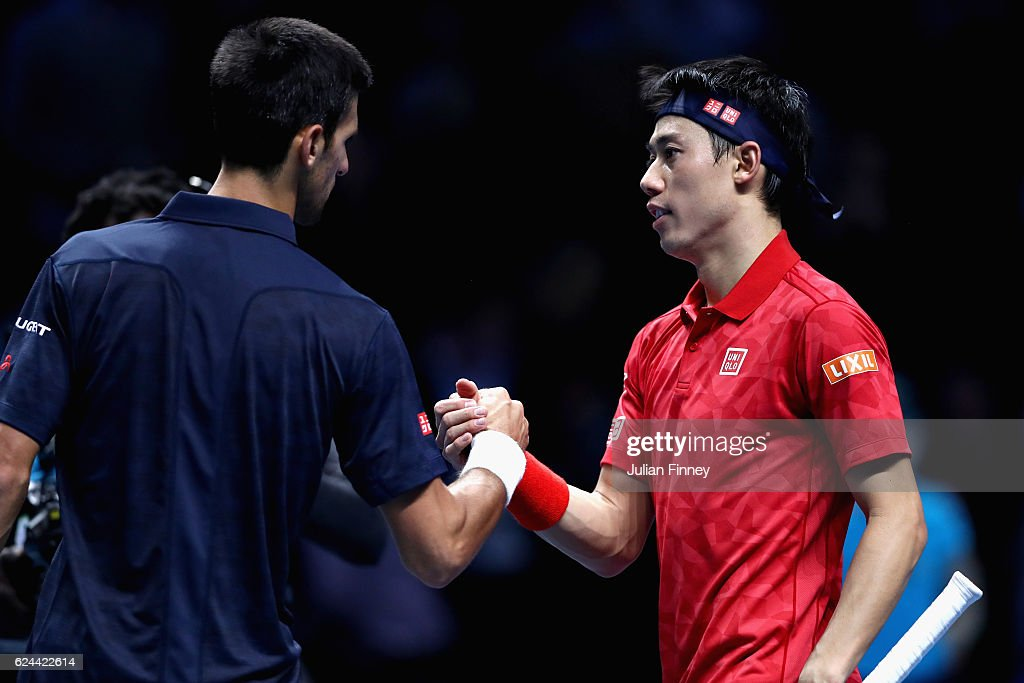 Novak Djokovic of Serbia is congratulated by Kei Nishikori of Japan after winning their men's singles semi final on day seven of the ATP World Tour Finals at O2 Arena on November 19, 2016 in London, England.