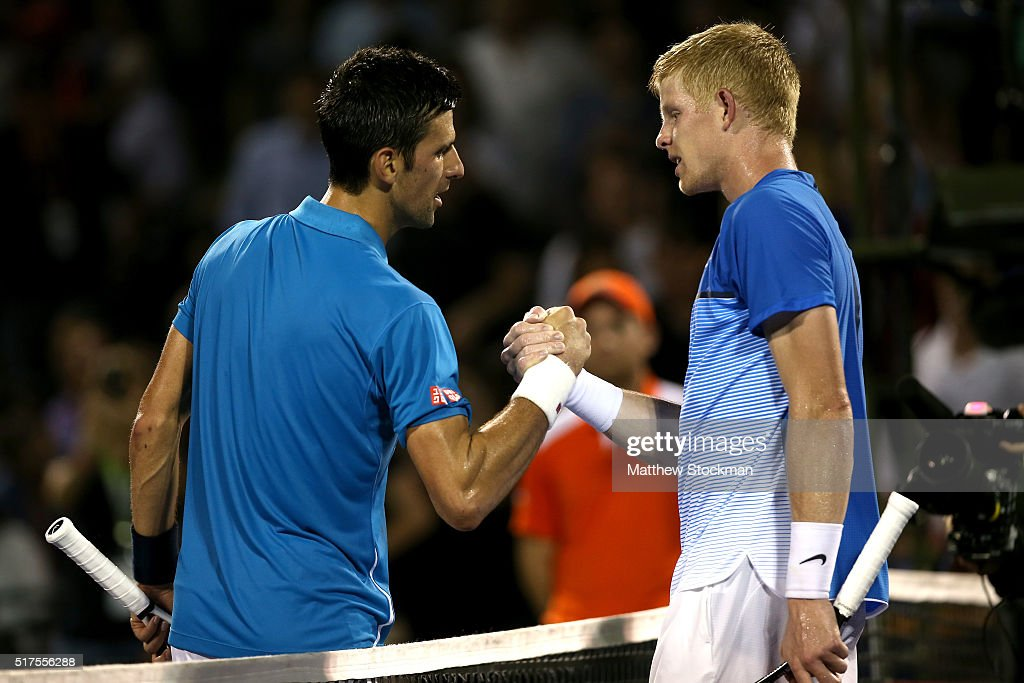 Novak Djokovic of Serbia is congratulated by Kyle Edmund of Great Britain during the Miami Open presented by Itau at Crandon Park Tennis Center on March 25, 2016 in Key Biscayne, Florida.