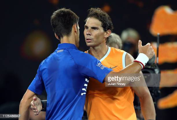 Novak Djokovic of Serbia is congratulated in his Men's Singles Final match by Rafael Nadal of Spain during day 14 of the 2019 Australian Open at...