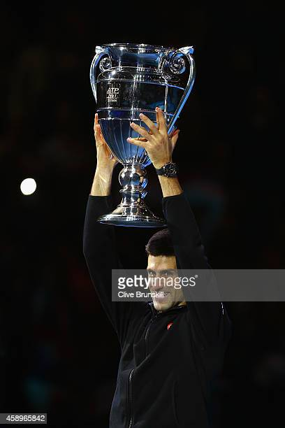 Novak Djokovic of Serbia is presented with the Barclays ATP World Tour No. 1 Award presented by Emirates after the the round robin singles match...