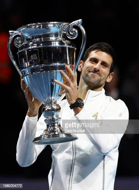 Novak Djokovic of Serbia is presented with the World Number one trophy during Day One of the Nitto ATP Finals at The O2 Arena on November 11 2018 in...