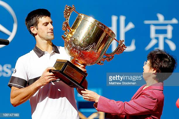 Novak Djokovic of Serbia is prresented with a trophy after defeating David Ferrer of Spain during the final on day eleven of the 2010 China Open at...