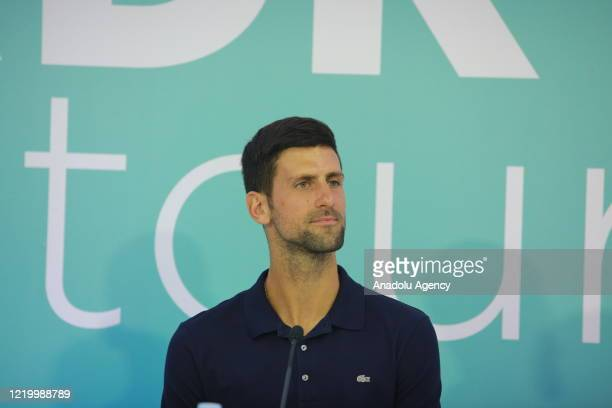 Novak Djokovic of Serbia is seen during a press conference held with Dominic Thiem of Austria after Thiem wins the final match against Filip...