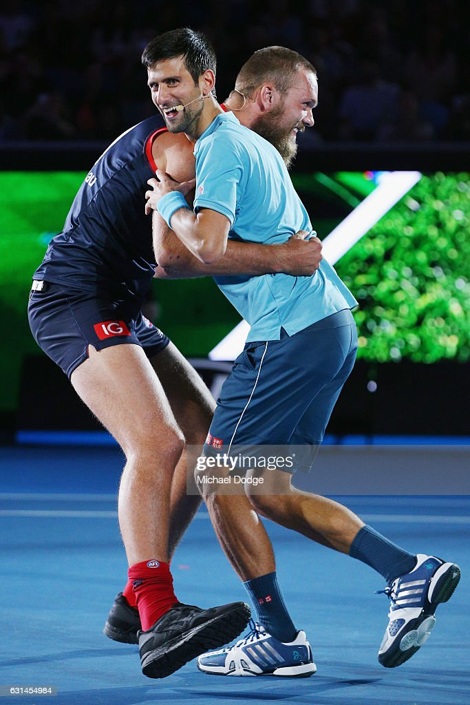 Novak Djokovic of Serbia is tackled by Melbourne Demons footballer Max Gawn during 'A Night with Novak' at Margaret Court Arena on January 11, 2017 in Melbourne, Australia.