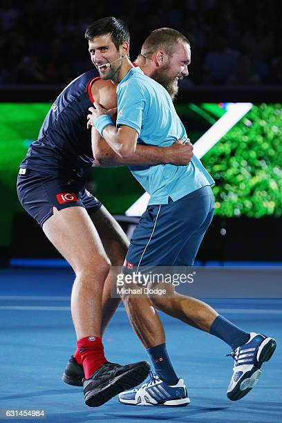 Novak Djokovic of Serbia is tackled by Melbourne Demons footballer Max Gawn during 'A Night with Novak' at Margaret Court Arena on January 11 2017 in...