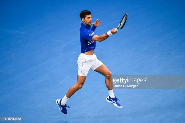 Novak Djokovic of Serbia Jumping to hit the ball during the Men's Singles Final match between Novak Djokovic of Serbia and Rafael Nadal of Spain...