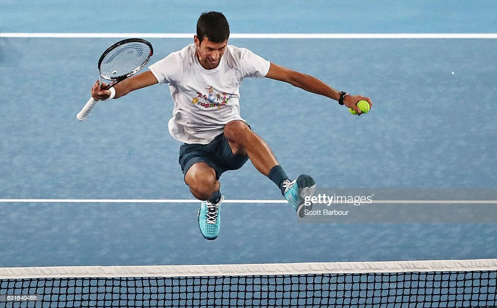 Novak Djokovic of Serbia jumps the net at the fifth annual Kids Tennis Day ahead of the 2017 Australian Open at Melbourne Park on January 14, 2017 in Melbourne, Australia.