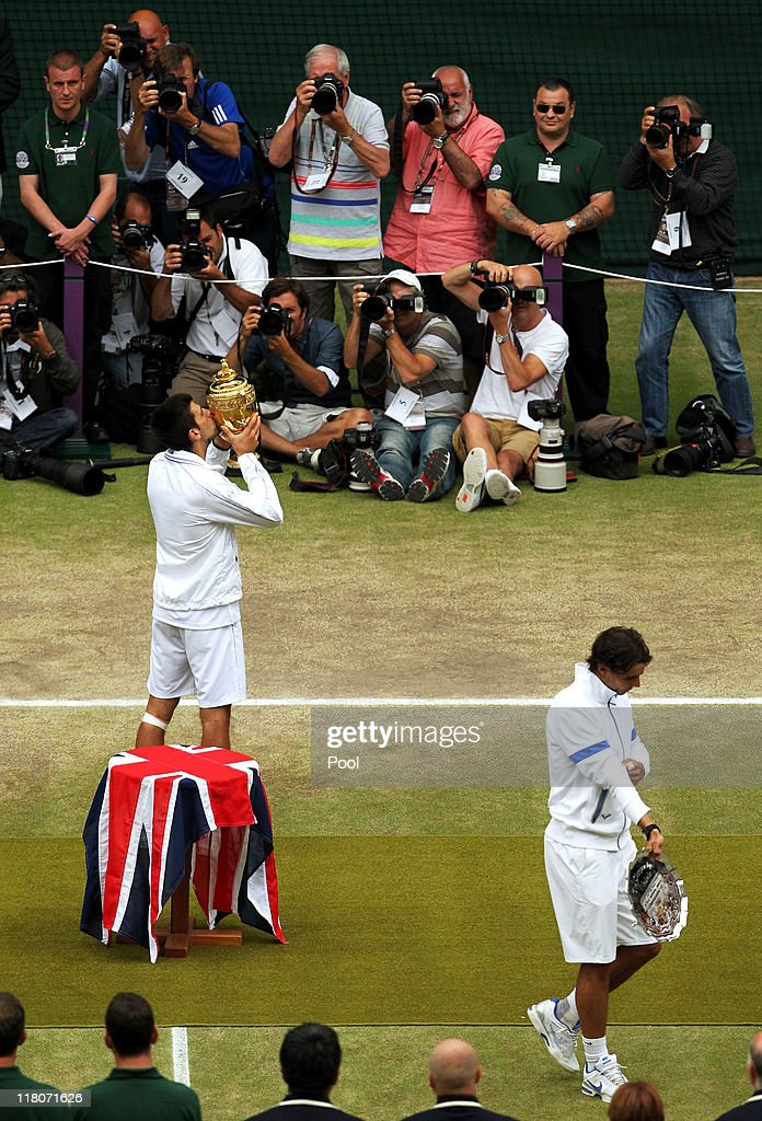 Novak Djokovic of Serbia kisses the championship trophy after winning his final round Gentlemen's match against Rafael Nadal of Spain on Day Thirteen of the Wimbledon Lawn Tennis Championships at the All England Lawn Tennis and Croquet Club on July 3, 2011 in London, England.