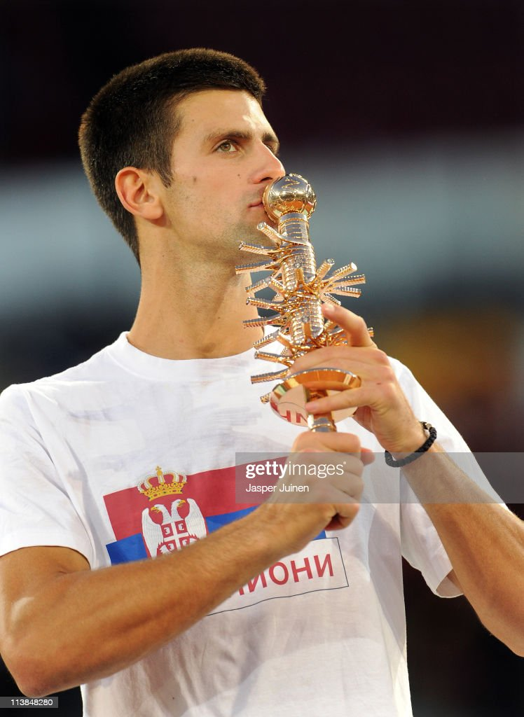 Novak Djokovic of Serbia kisses the Ion Tiriac's trophy after winning his final match against Rafael Nadal of Spain in straight sets during day eight of the Mutua Madrilena Madrid Open Tennis on May 8, 2011 in Madrid, Spain.
