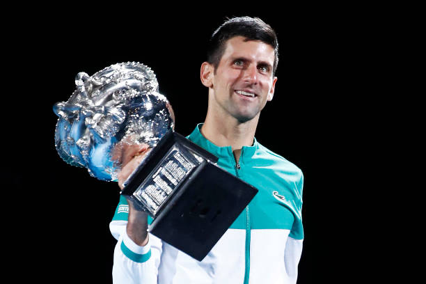 Novak Djokovic of Serbia kisses the Norman Brookes Challenge Cup as he celebrates victory in his Men's Singles Final match against Daniil Medvedev of...