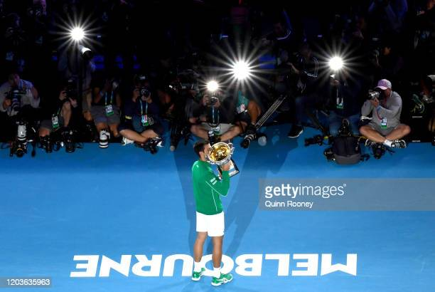Novak Djokovic of Serbia kisses the Norman Brookes Challenge Cup after winning the Men's Singles Final against Dominic Thiem of Austria on day...