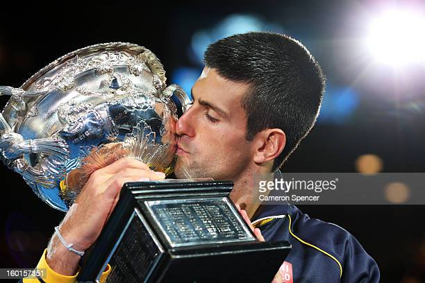 Novak Djokovic of Serbia kisses the Norman Brookes Challenge Cup after winning his men's final match against Andy Murray of Great Britain during day...