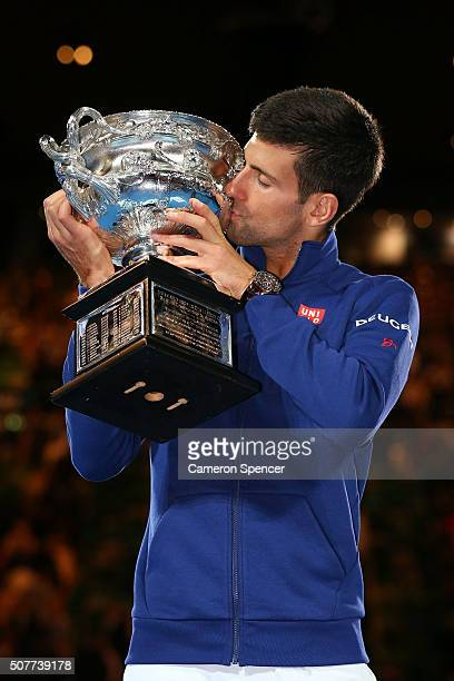 Novak Djokovic of Serbia kisses the Norman Brookes Challenge Cup after winning the Men's Singles Final over Andy Murray of Great Britain during day...