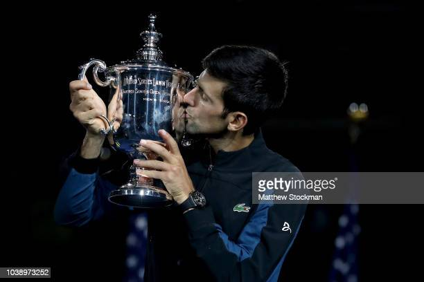 Novak Djokovic of Serbia kisses the trophy as he celebrates his win over Juan Martin Del Potro of Argentina during the men's final of the US Open at...