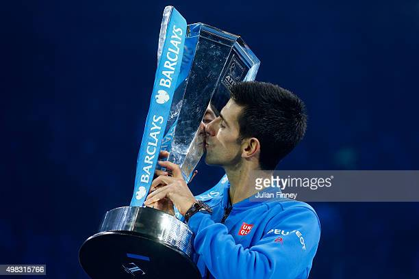 Novak Djokovic of Serbia kisses the trophy following his victory during the men's singles final against Roger Federer of Switzerland on day eight of...