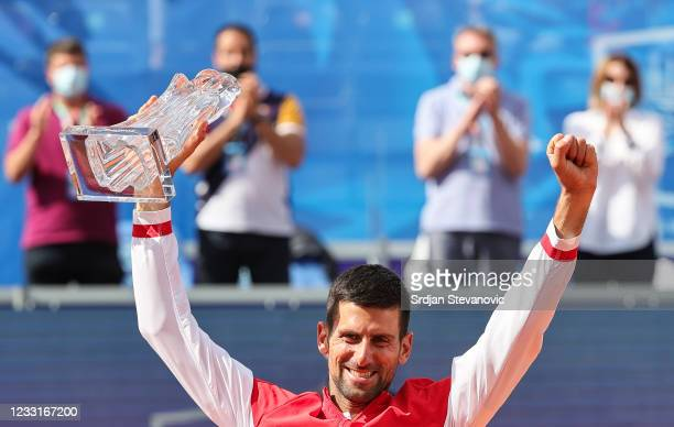 Novak Djokovic of Serbia kisses the winning trophy after his men's singles Final match against Alex Molcan of Slovakia on Day 7 of the ATP 250...