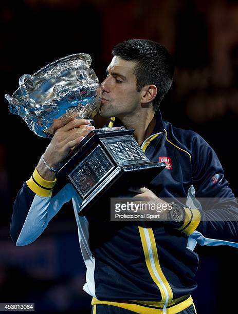 Novak Djokovic of Serbia kissing the Norman Brookes Challenge Cup after winning his men's final match against Andy Murray of Great Britain during day...