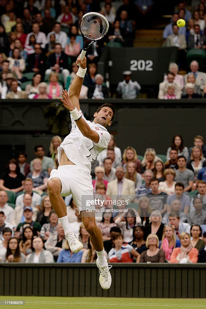 Novak Djokovic of Serbia leaps to smash the ball during his Gentlemen's Singles second round match against Bobby Reynolds of the United States of America on day four of the Wimbledon Lawn Tennis Championships at the All England Lawn Tennis and Croquet Club on June 27, 2013 in London, England.