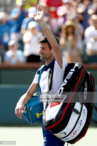 Novak Djokovic of Serbia leaves the court after losing to Taro Daniel of Japan during the BNP Paribas Open at the Indian Wells Tennis Garden on March...