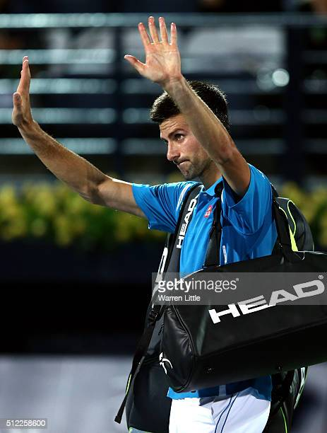 Novak Djokovic of Serbia leaves the court as he withdraws from his quarter final match against Feliciano Lopez of Spain on day six of the ATP Dubai...