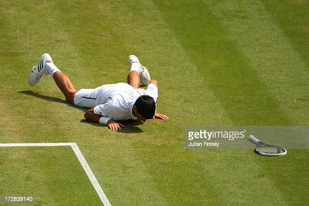 Novak Djokovic of Serbia lies on the grass after slipping during the Gentlemen's Singles semifinal match against Juan Martin Del Potro of Argentina...