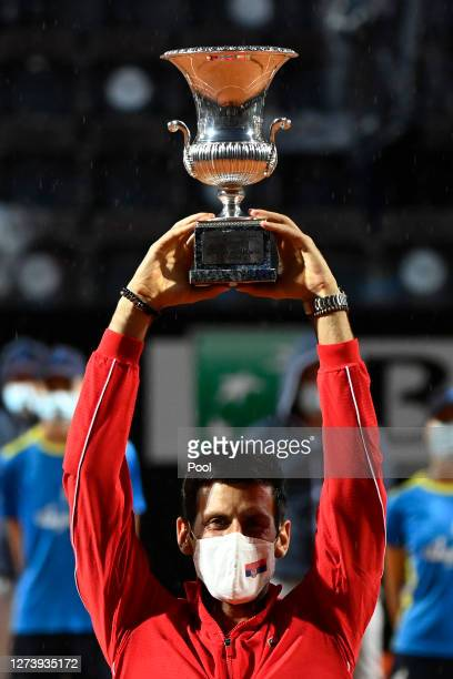 Novak Djokovic of Serbia lifts the trophy after winning his men's final match against Diego Schwartzman of Argentina during day eight of the...