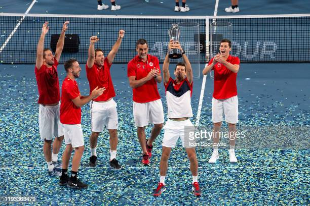Novak Djokovic of Serbia lifts the trophy during day ten of the finals at the 2020 ATP Cup Tennis at Ken Rosewall Arena on January 12, 2020 in...