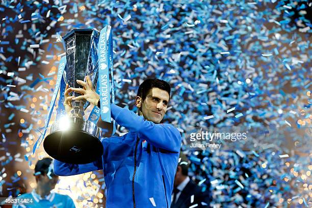 Novak Djokovic of Serbia lifts the trophy following his victory during the men's singles final against Roger Federer of Switzerland on day eight of...
