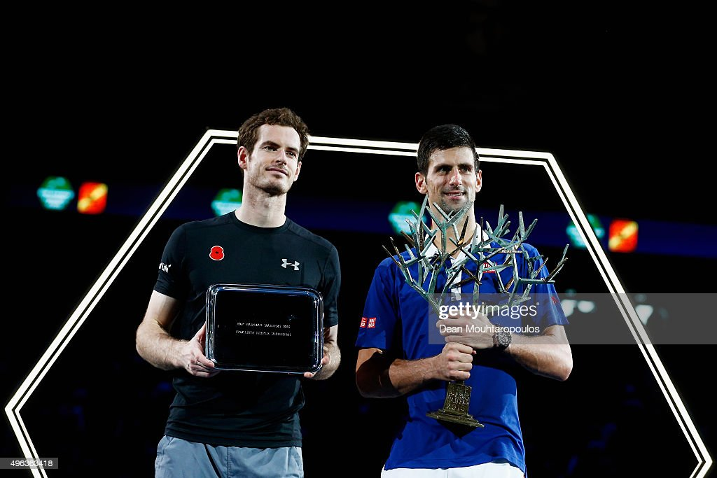 Novak Djokovic (R) of Serbia lifts the winners trophy after victory against Andy Murray (L) of Great Britain after their Mens Final match during Day 7 of the BNP Paribas Masters held at AccorHotels Arena on November 8, 2015 in Paris, France.