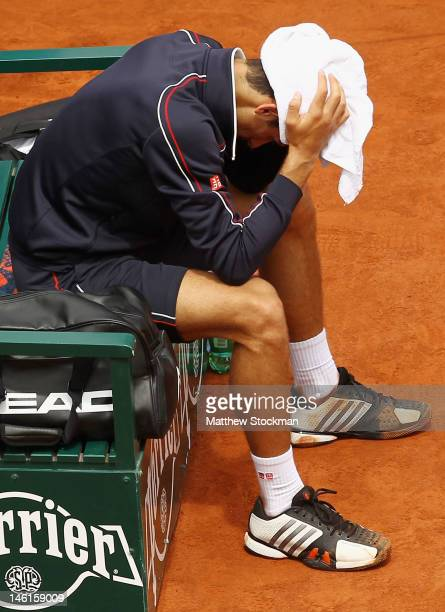 Novak Djokovic of Serbia looks dejected after the men's singles final against Rafael Nadal of Spain on day 16 of the French Open at Roland Garros on...