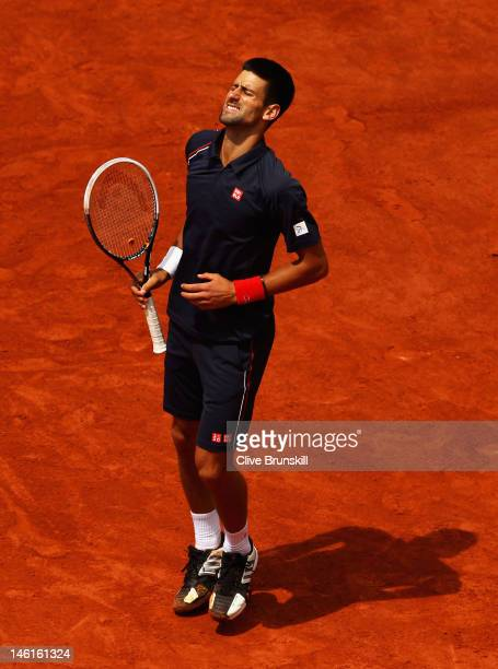 Novak Djokovic of Serbia looks dejected during the men's singles final against Rafael Nadal of Spain on day 16 of the French Open at Roland Garros on...