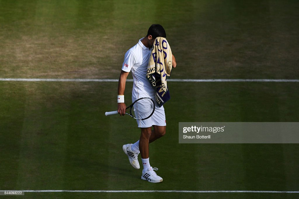 Novak Djokovic of Serbia looks dejected during the Men's Singles third round match against Sam Querrey of The United States on day five of the Wimbledon Lawn Tennis Championships at the All England Lawn Tennis and Croquet Club on July 1, 2016 in London, England.