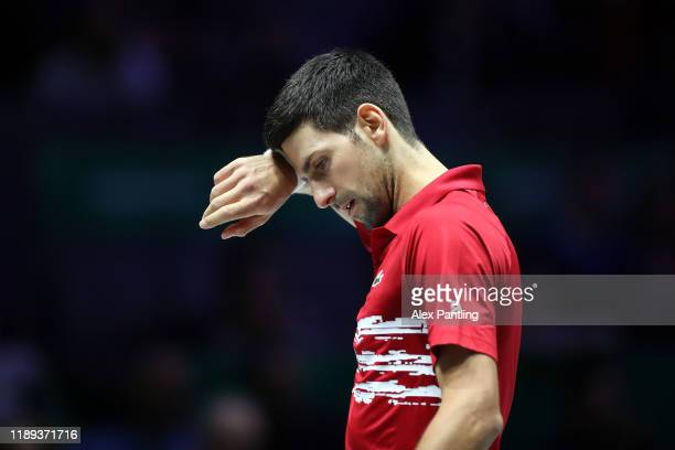 Novak Djokovic of Serbia looks on during his quarter final doubles match against Russia on Day Five of the 2019 Davis Cup at La Caja Magica on...