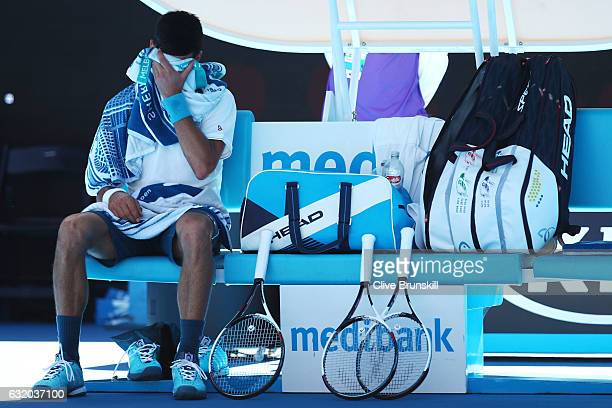 Novak Djokovic of Serbia looks on from his chair between games in his second round match against Denis Istomin of Uzbekistan on day four of the 2017...