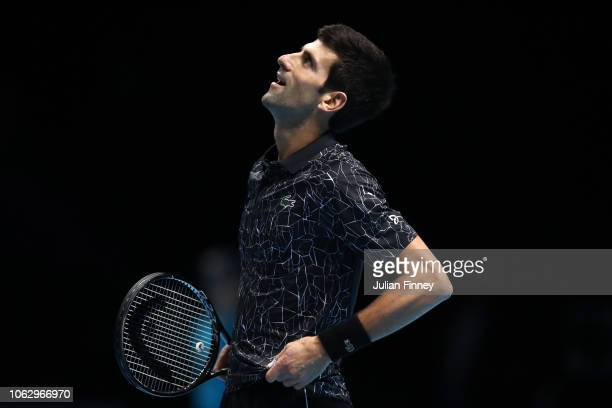 Novak Djokovic of Serbia looks on in his semi finals singles match against Kevin Anderson of South Africa during Day Seven of the Nitto ATP Finals at...