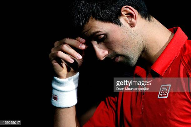 Novak Djokovic of Serbia looks on prior to his match against Sam Querrey of USA during day 3 of the BNP Paribas Masters at Palais Omnisports de Bercy...