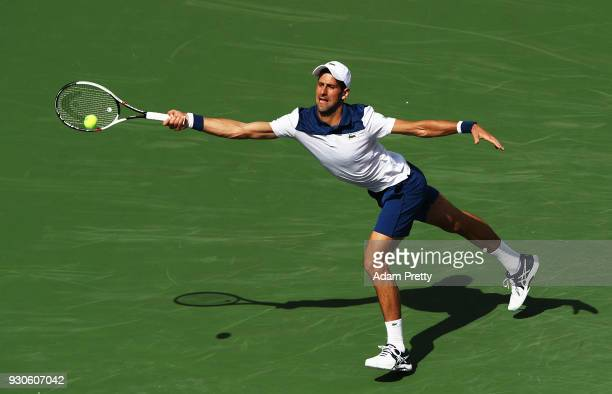 Novak Djokovic of Serbia lunges during his match against Taro Daniel of Japan during the BNP Paribas Open at the Indian Wells Tennis Garden of the...