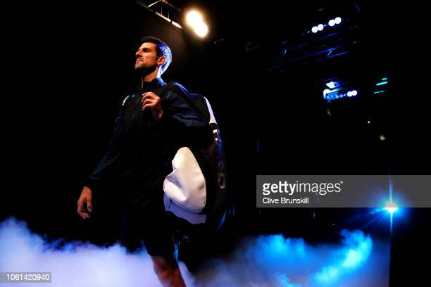 Novak Djokovic of Serbia makes his way out onto court for his singles round robin match against Alexander Zverev of Germany during Day Four of the...