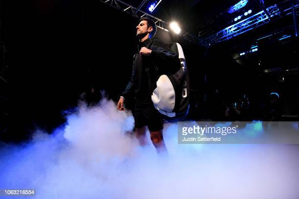 Novak Djokovic of Serbia makes his way out onto court for his singles final against Alexander Zverev of Germany during Day Eight of the Nitto ATP...