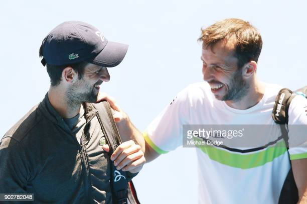 Novak Djokovic of Serbia making a comeback from an elbow injury is seen with Radek Stepanek of the Czech Republic after a practice session ahead of...