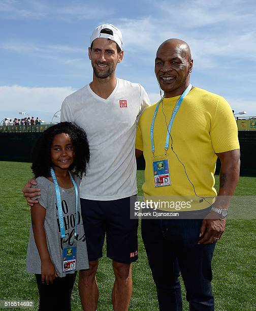 Novak Djokovic of Serbia meets Mike Tyson and daughter Milan Tyson during day seven of the BNP Paribas Open at Indian Wells Tennis Garden on March 13...
