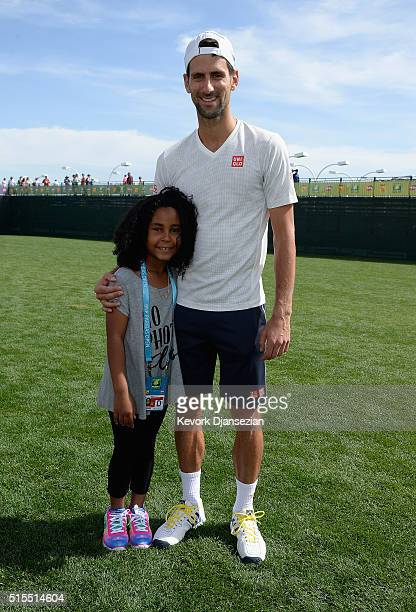 Novak Djokovic of Serbia meets Milan Tyson during day seven of the BNP Paribas Open at Indian Wells Tennis Garden on March 13 2016 in Indian Wells...