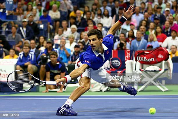 Novak Djokovic of Serbia misses a backhand shot against Roger Federer of Switzerland during their Men's Singles Final match on Day Fourteen of the...